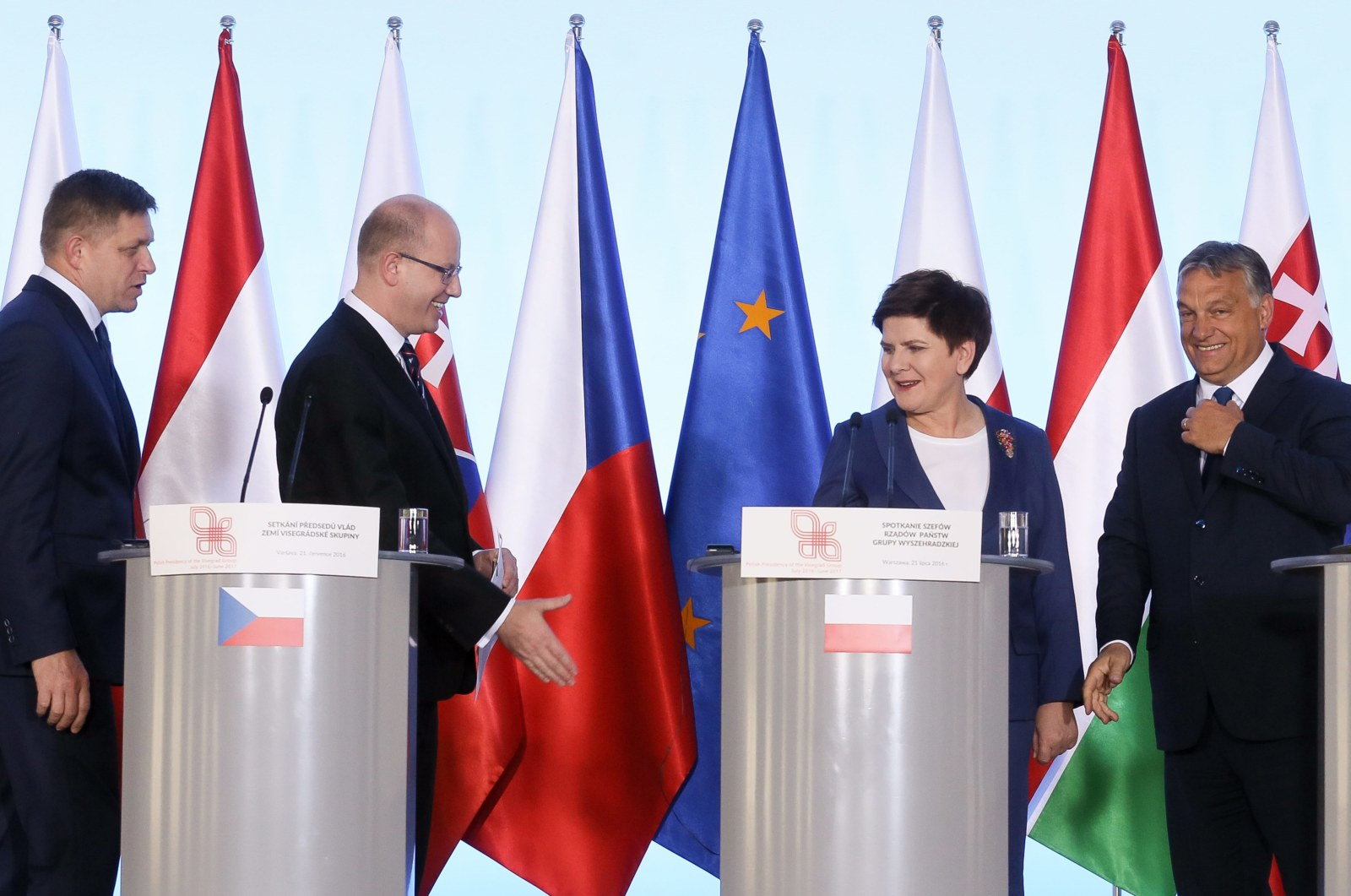 epa05434869 Polish Prime Minister Beata Szydlo (2-R), Hungarian Prime Minister Viktor Orban (R), Slovakia's Prime Minister Robert Fico (L) and Czech Prime Minister Bohuslav Sobotka (2-L) at a press conference after the Visegrad Group Prime Ministers meeting in Warsaw, Poland, 21 July 2016. The V4 prime ministers talked about the future of the European Union after the Brexit vote in Britain ahead of an informal EU summit in Bratislava in September that is expected to discuss the situation in Europe after Britain?s decision to leave the bloc. Poland and other V4 countries want to play a role in this discussion EPA/PAWEL SUPERNAK POLAND OUT